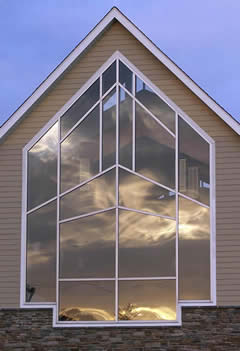 Artistic image of a group of windows reflecting the sky and horizon